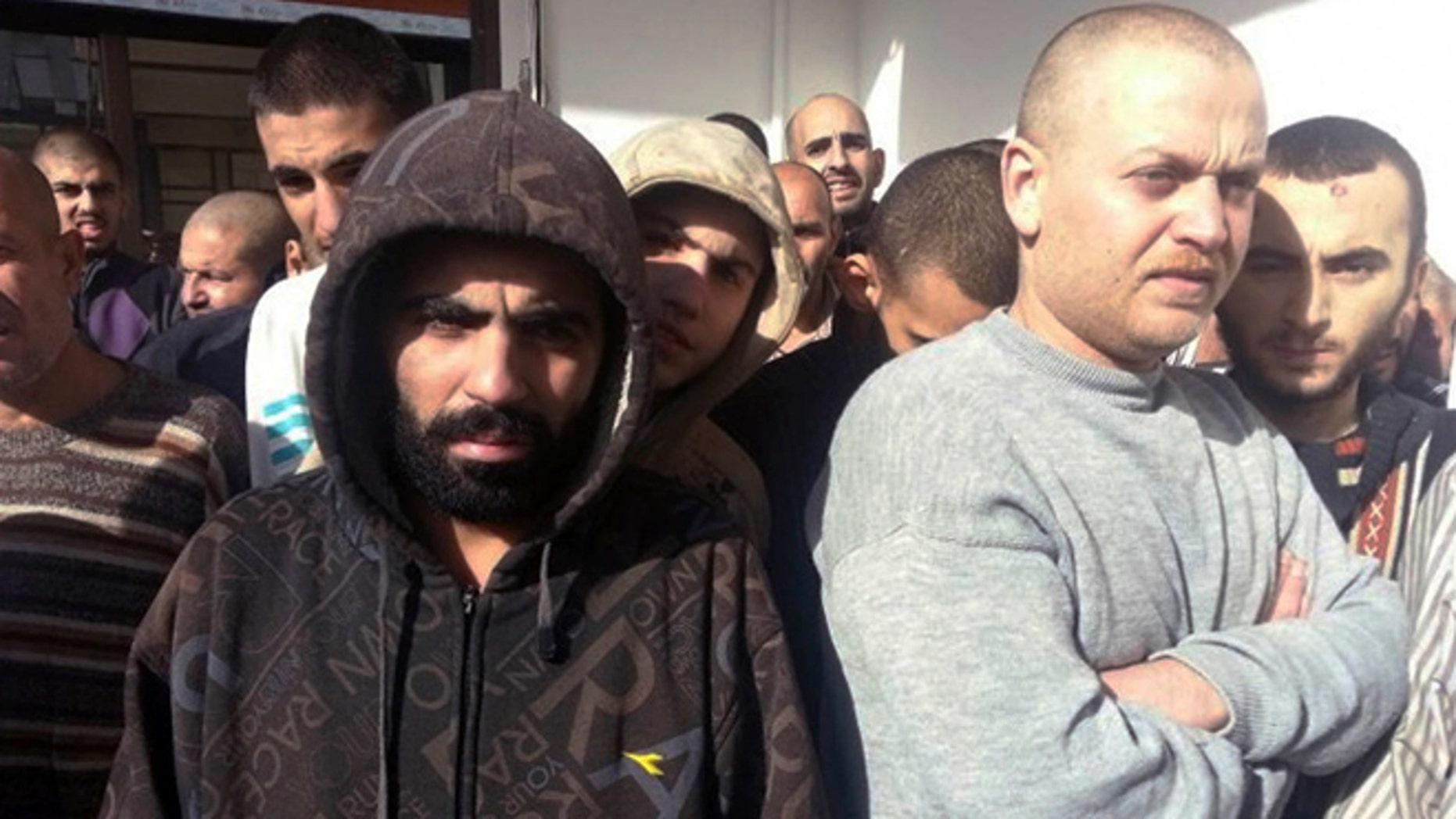 Jan. 9, 2013: In this photo provided by the Turkish Islamic aid group IHH, freed Syrian prisoners released by the Syrian government are seen in Damascus, Syria.