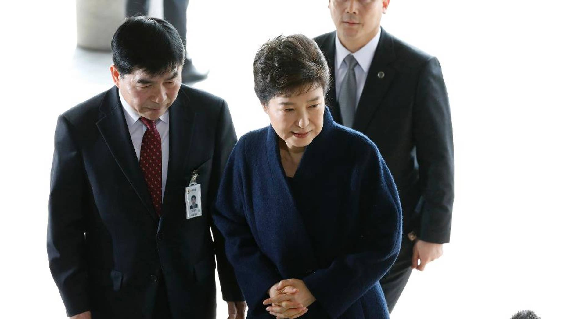 FILE - In this Tuesday, March, 21, 2017 file photo, South Korea's ousted leader Park Geun-hye arrives at a prosecutor's office in Seoul, South Korea. Park has decided to attend a questioning session by a Seoul court before it determines whether she should be arrested over explosive corruption allegations, prosecutors said Tuesday, March 28. (Kim Hong-ji/Pool Photo via AP, File)