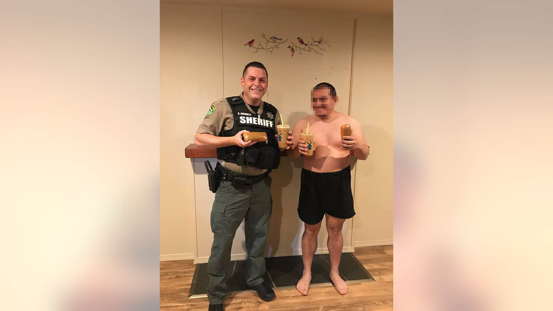 Deputy Chris Nicholls sharing coffee and donuts with the patient.