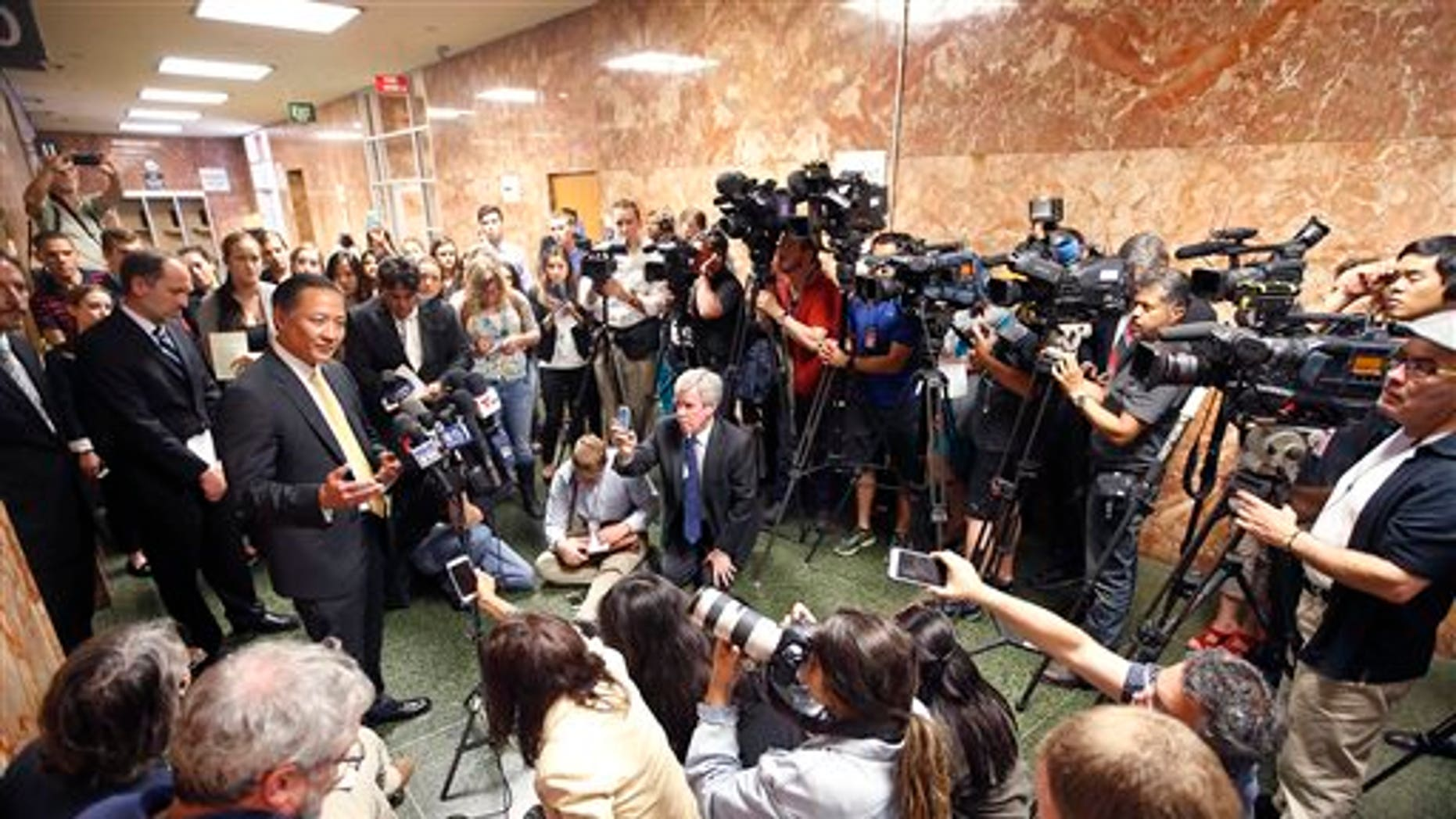 San Francisco Public Defender Jeff Adachi, left, talks to members of the media after Francisco Sanchez's arraignment Tuesday, July 7, 2015, in San Francisco.