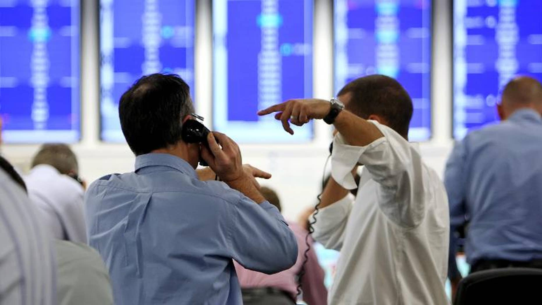 Brokers on ICAP's dealing floor, in London, on October 8, 2008.