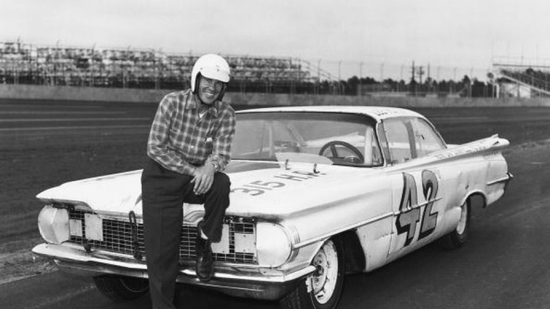 DAYTONA BEACH, FL - FEBRUARY 22: Lee Petty driver of the #42 Oldsmobile poses in front of his car before the first 1959 Winston Cup Daytona 500 race at the Daytona International Speedway on February 22, 1959 in Daytona Beach, Florida. He would win the first Daytona 500. (Photo by ISC Archives via Getty Images)