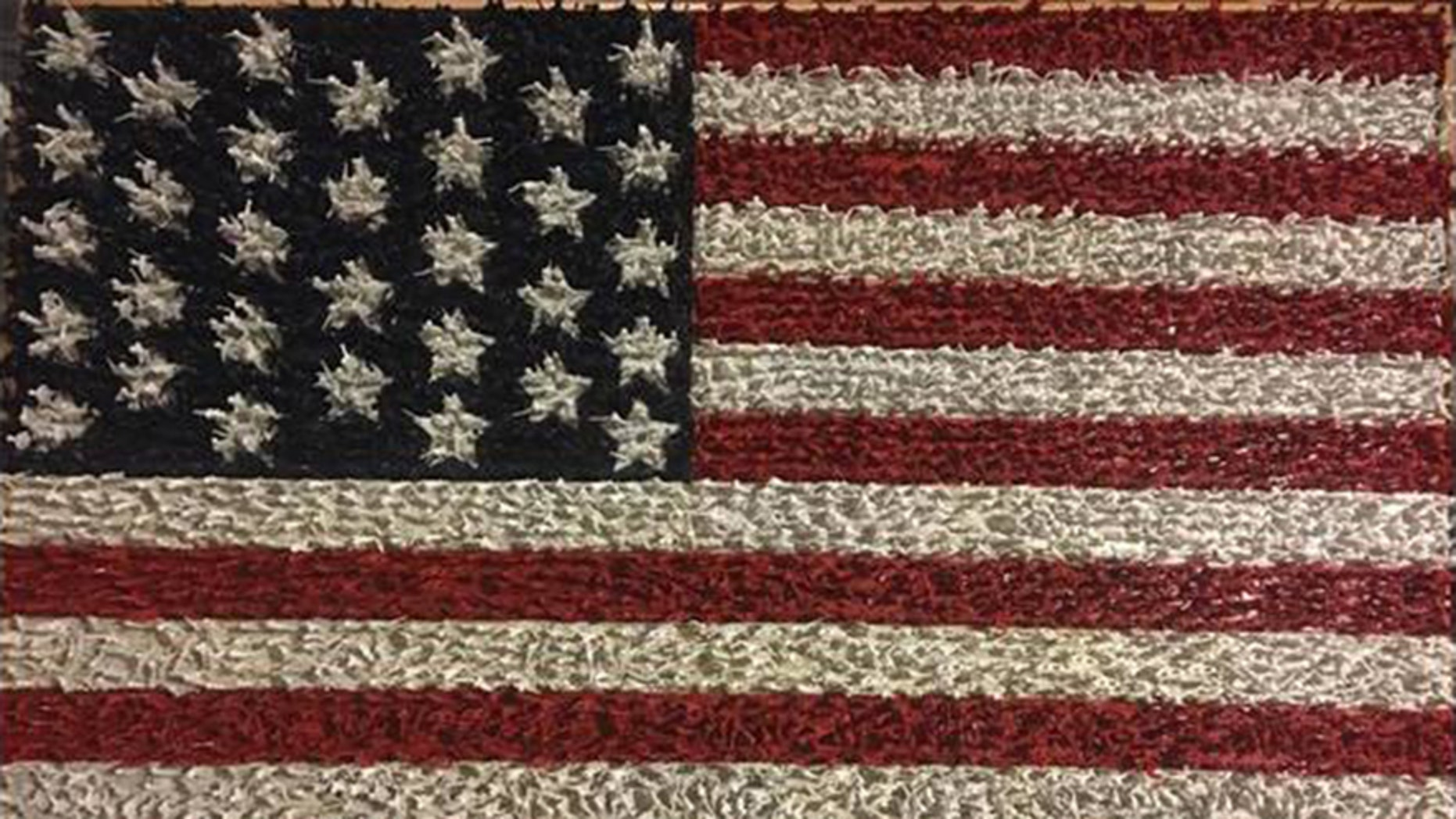 Greg Smith, of LaGrange, Georgia, used more than 10,000 plastic Army men to create an American flag.