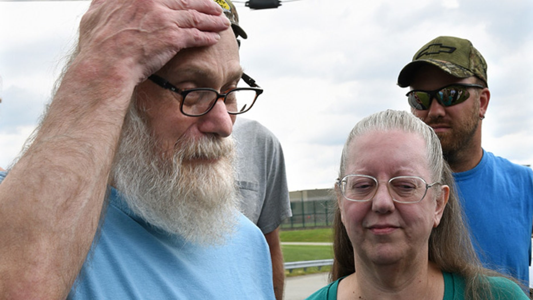 Aug. 13, 2015: Lewis Fogle, pictured with his wife, Deb, becomes emotional after his release from the State Correctional Institution in Pine Grove, Pa. Fogle, who spent 34 years imprisoned for the 1976 murder of a 15-year-old girl, was released after DNA tests proved his was not the person who committed the crime. (Bob Donaldson/Pittsburgh Post-Gazette via AP)