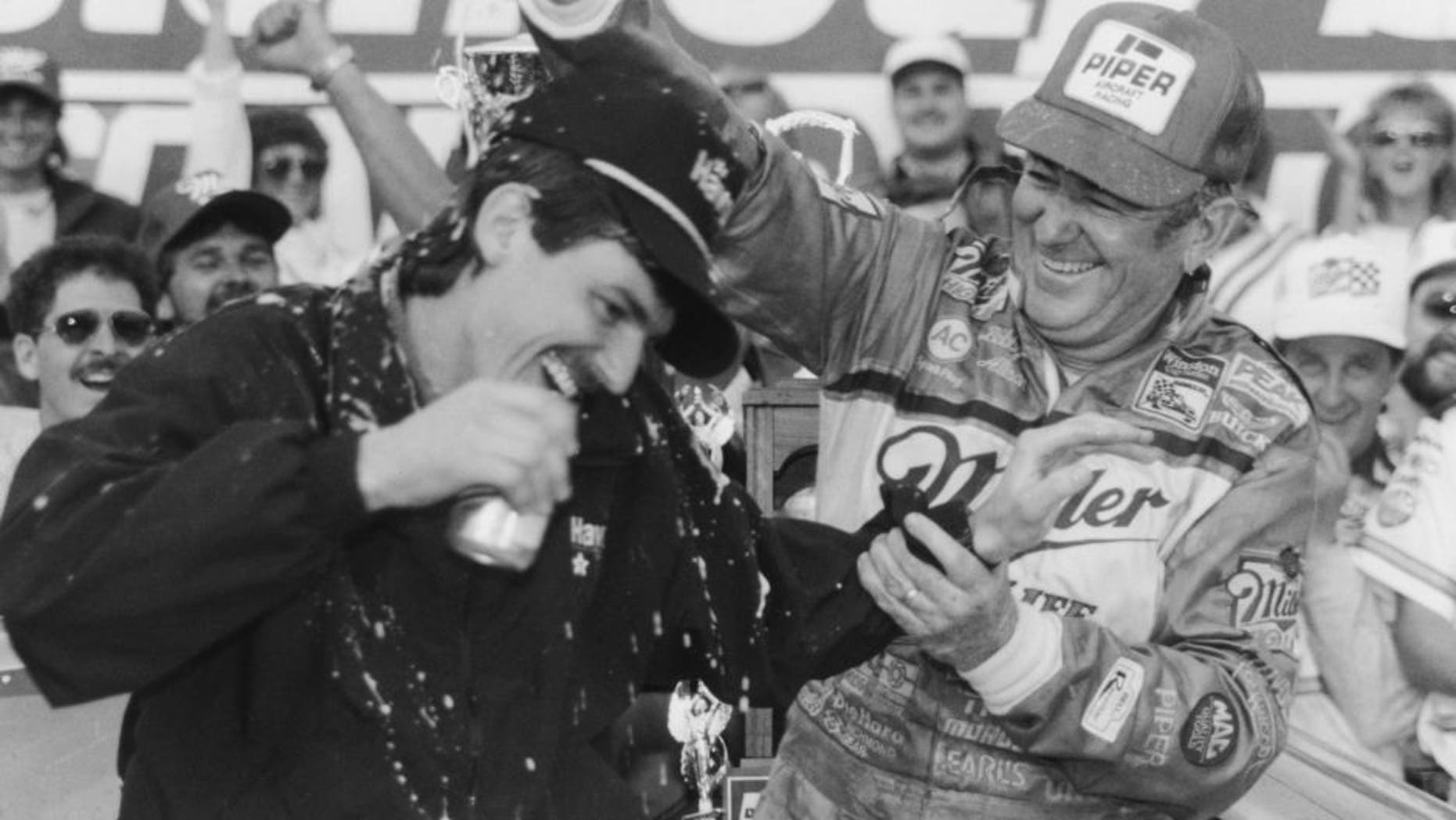DAYTONA BEACH, FL - FEBRUARY 14: Bobby Allison driver of the #12 Buick celebrates with his son Davey (Feb 25, 1961-July 13, 1993) driver of the Robert Yates Racing #28 Texaco-Havoline Ford after winning the 1988 NASCAR Winston Cup Daytona 500 at the Daytona International Speedway on February 14, 1988 in Daytona Beach, Florida. (Photo by ISC Archives via Getty Images)