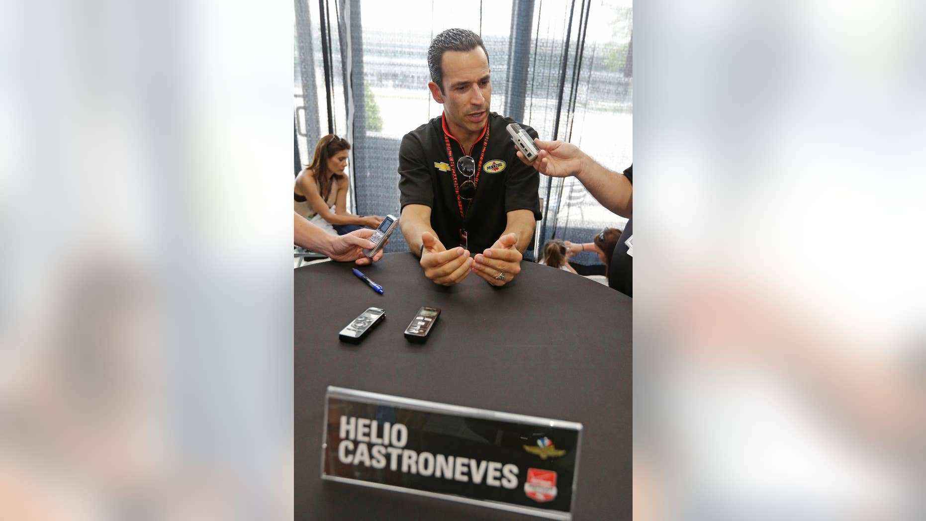 Helio Castroneves, of Brazil, responds to a question during media interview for the Indianapolis 500 IndyCar auto race at the Indianapolis Motor Speedway in Indianapolis, Thursday, May 22, 2014. (AP Photo/Darron Cummings)