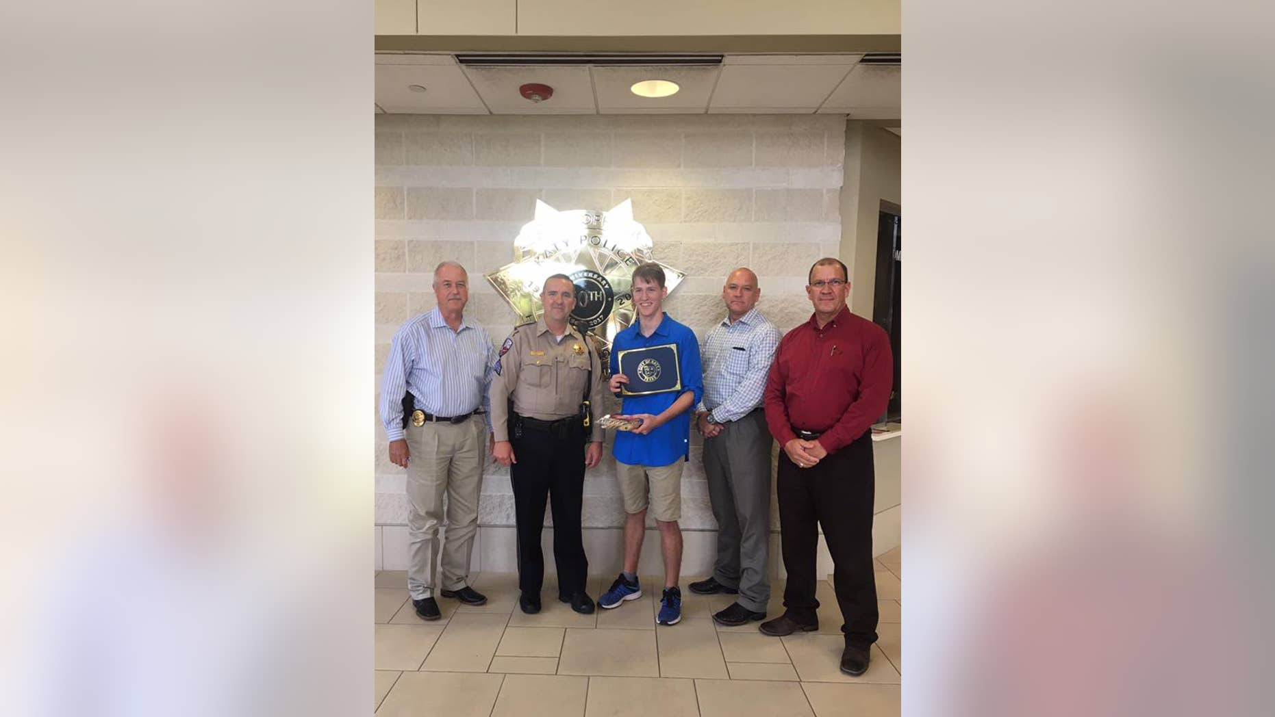 The Katy Police Department in Texas honored Zachary Randolph for purchasing an officer an item from a cookie store. (Katy Police Department)