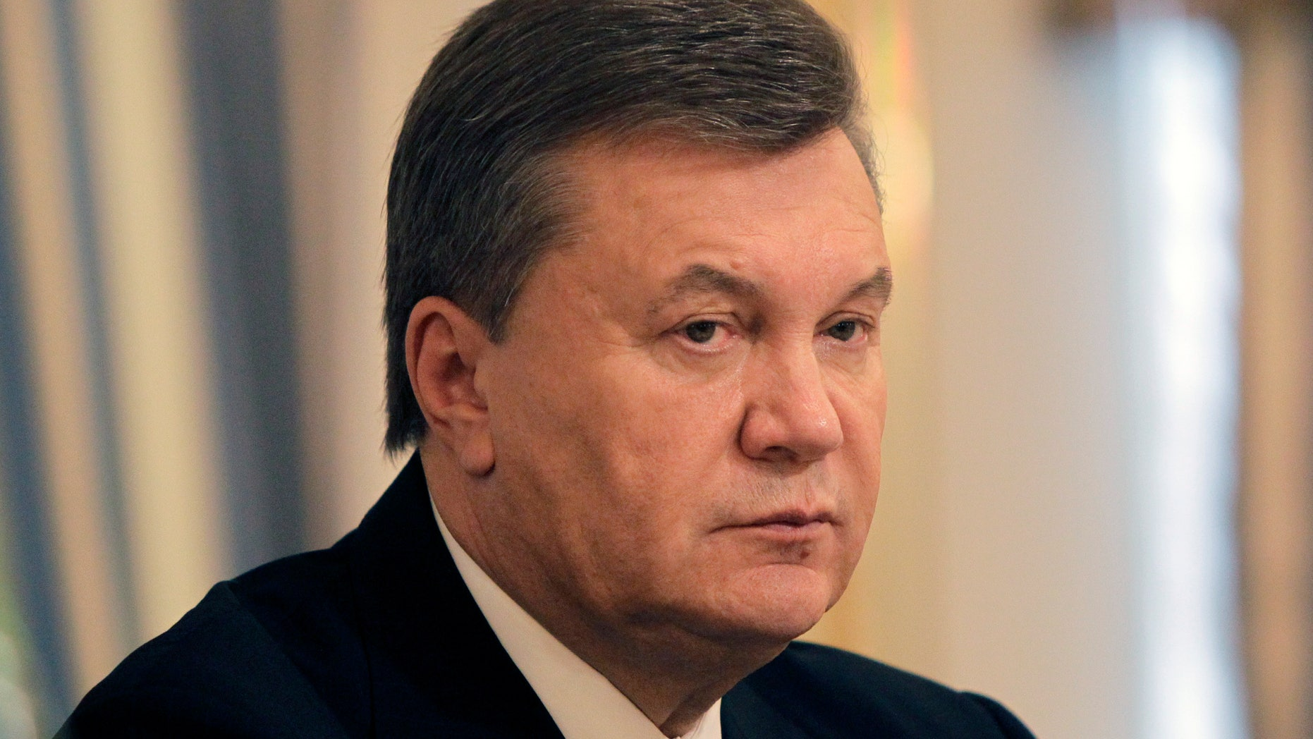 Ukrainian President Viktor Yanukovych during their meeting with EU Commissioner for Enlargement and European Neighborhood policy Stefan Fule in Kiev, Ukraine, Friday, Oct. 11, 2013.Ukrainian President Viktor Yanukovych is hoping for a quick solution to the problem the jailed former premier Yulia Tymoshenko, whose release is a key condition for a landmark agreement with the European Union.(AP Photo/Sergei Chuzavkov,Pool)