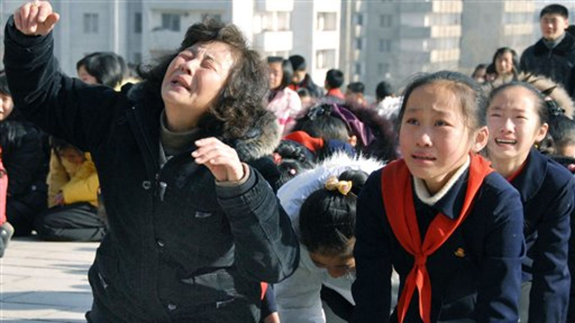 December 19, 2011: North Korean women cry after learning death of their leader Kim Jong Il.