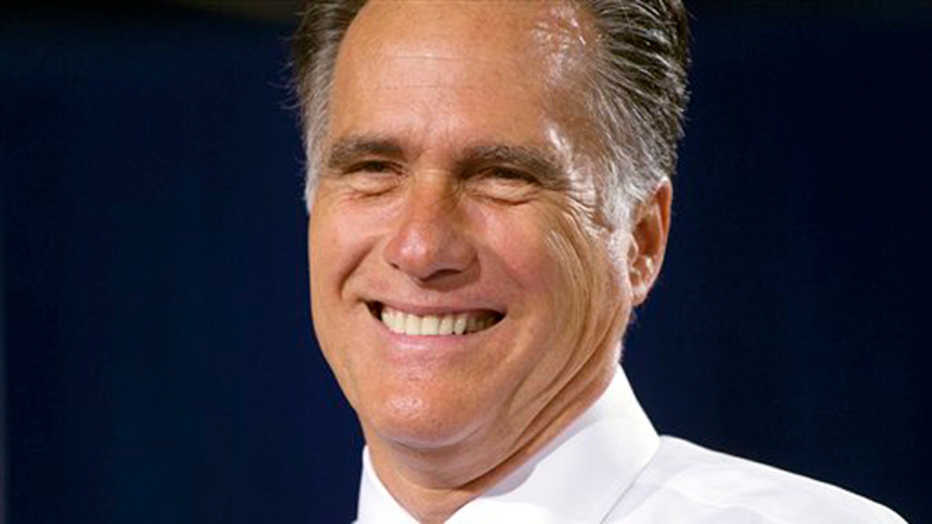 Republican presidential candidate, former Massachusetts Gov. Mitt Romney smiles during a campaign stop on Wednesday, July 18, 2012 in Bowling Green, Ohio.  (AP Photo/Evan Vucci)