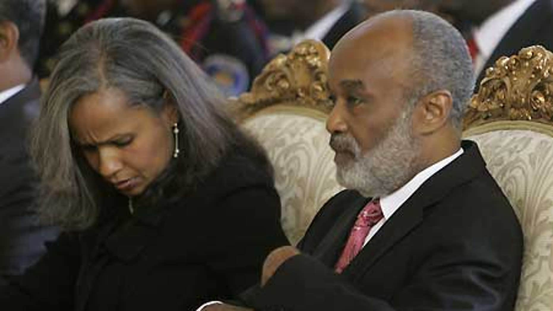 Jan. 1: Haiti's President Rene Preval sits with his wife, fist lady Elisabeth Debrosse Delatour.
