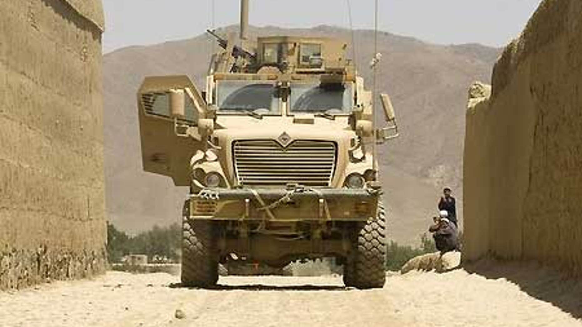 July 22: U.S. army Mine Resistant Ambush Protect armored vehicle parks in Logar Province, Afghanistan.