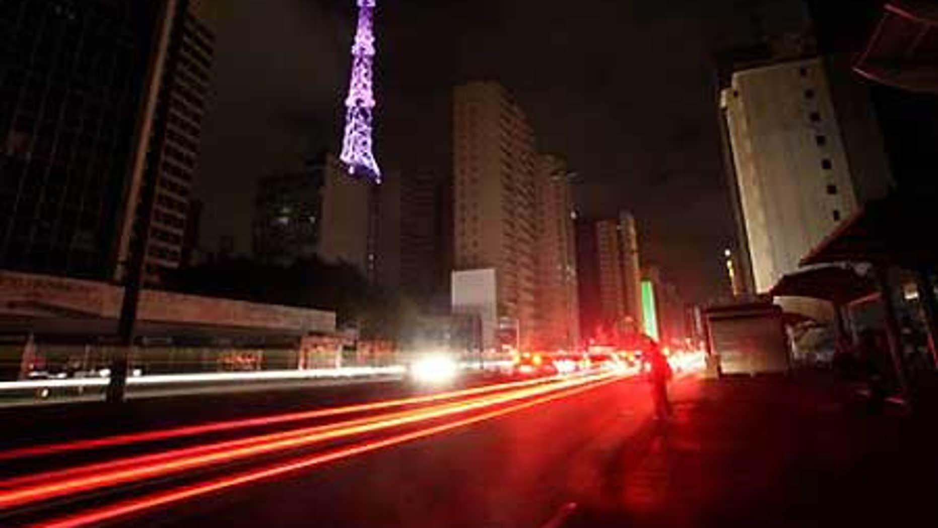 Nov. 10: Cars drive down Paulista Avenue in Sao Paulo, Brazil during a blackout.
