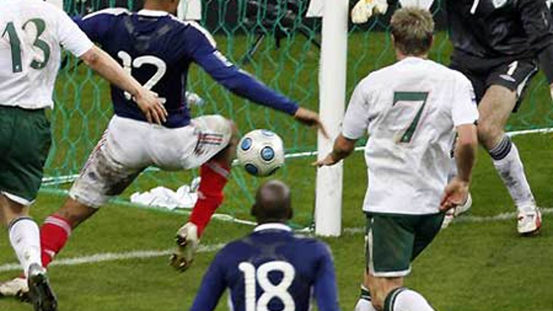 Nov. 18: France's Thierry Henry, second left, passes the ball just before William Gallas (unseen) scored goal for France during World Cup qualifyier.