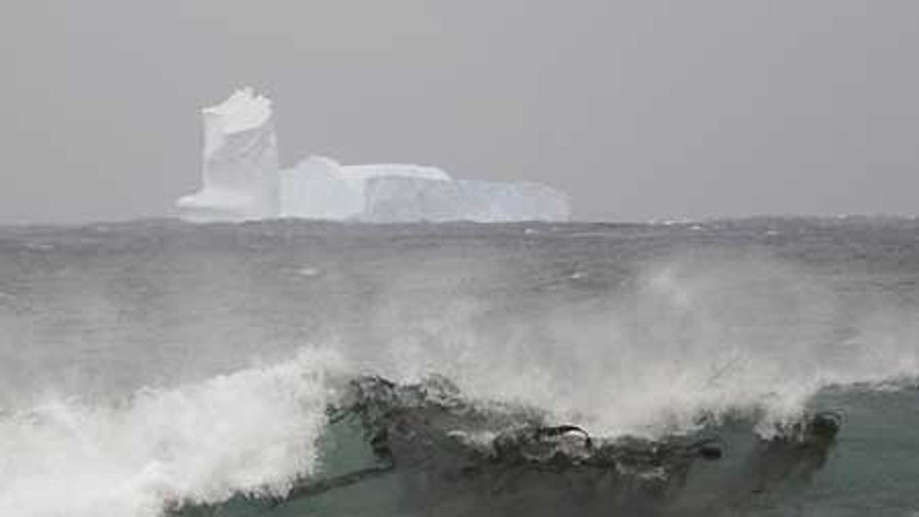 Nov. 16: An iceberg is seen at Sandy Bay on Macquarie Island's east coast, in the Southern Ocean 930 miles southeast of Tasmania, Australia.
