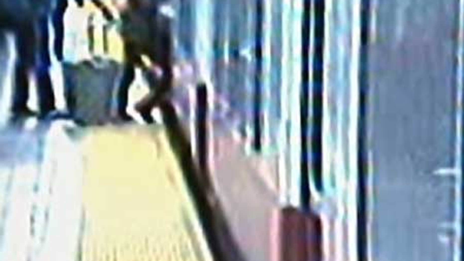 Woman's bag gets stuck trying to get on an MBTA train in Boston.