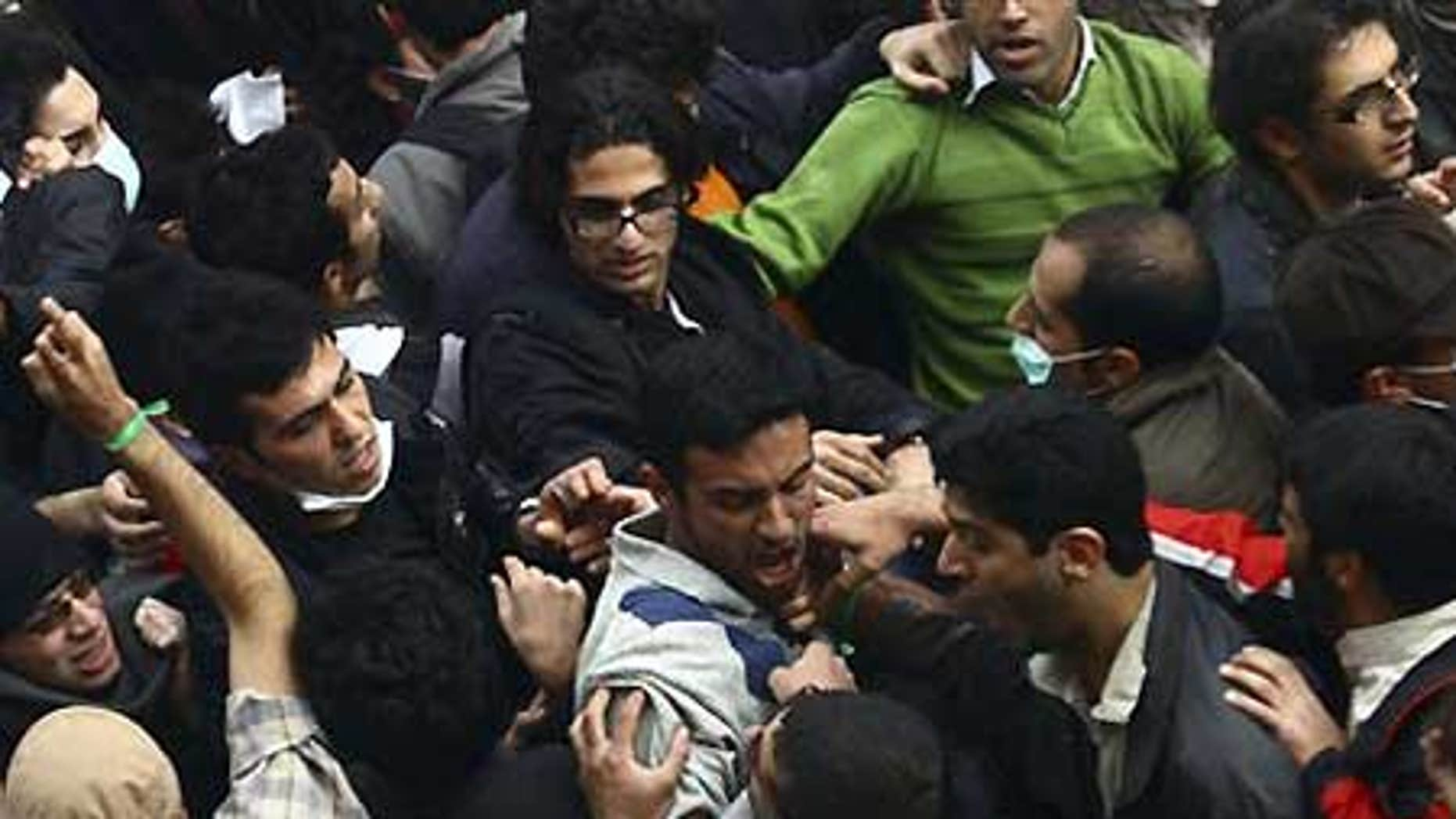 Dec. 7: Pro-reform Iranian students and hard-line students scuffle during their demonstrations at the Tehran University campus in Iran.
