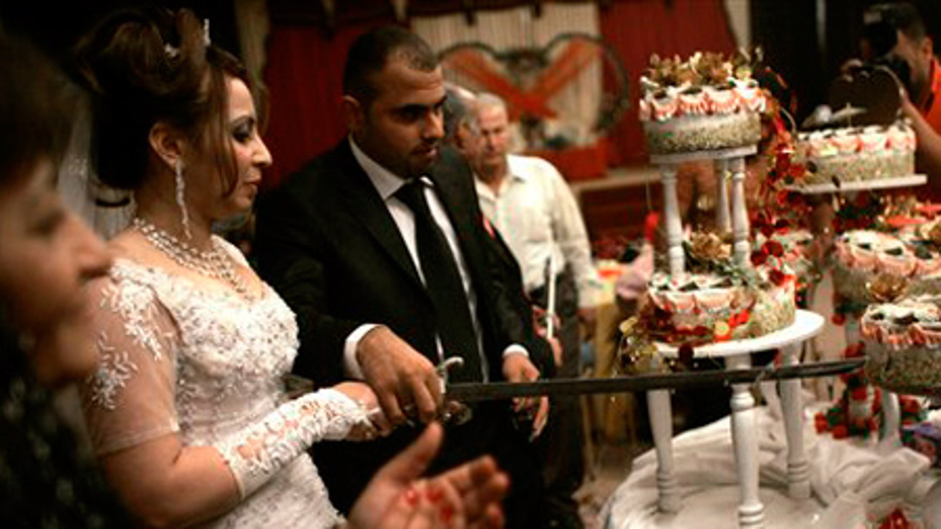 April 16: Maysa Abdul-Rahim and Rahim Nouri cut the wedding cake with a sword at their wedding ceremony in Baghdad, Iraq.
