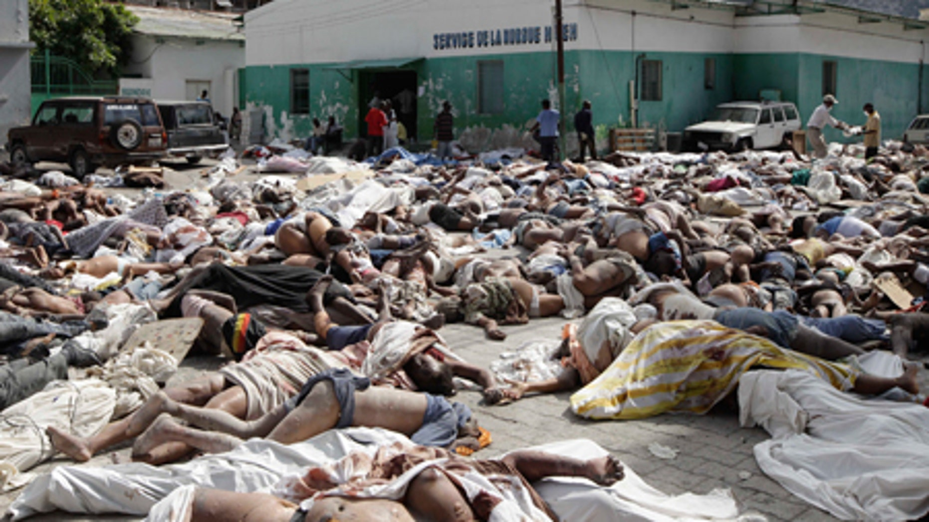 Hundreds of bodies of earthquake victims lay outside the morgue in Port-au-Prince, Thursday, Jan. 14, 2010.