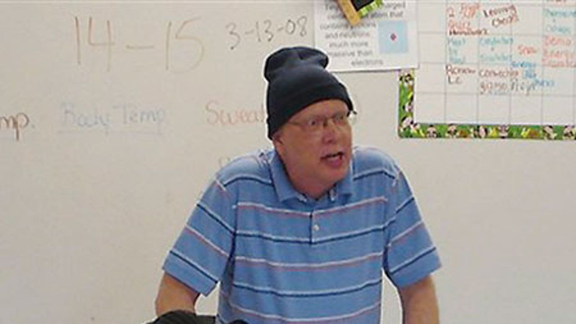 Undated 2008 photo: Bill Sparkman speaks to a 7th grade class during a lesson about sound waves.