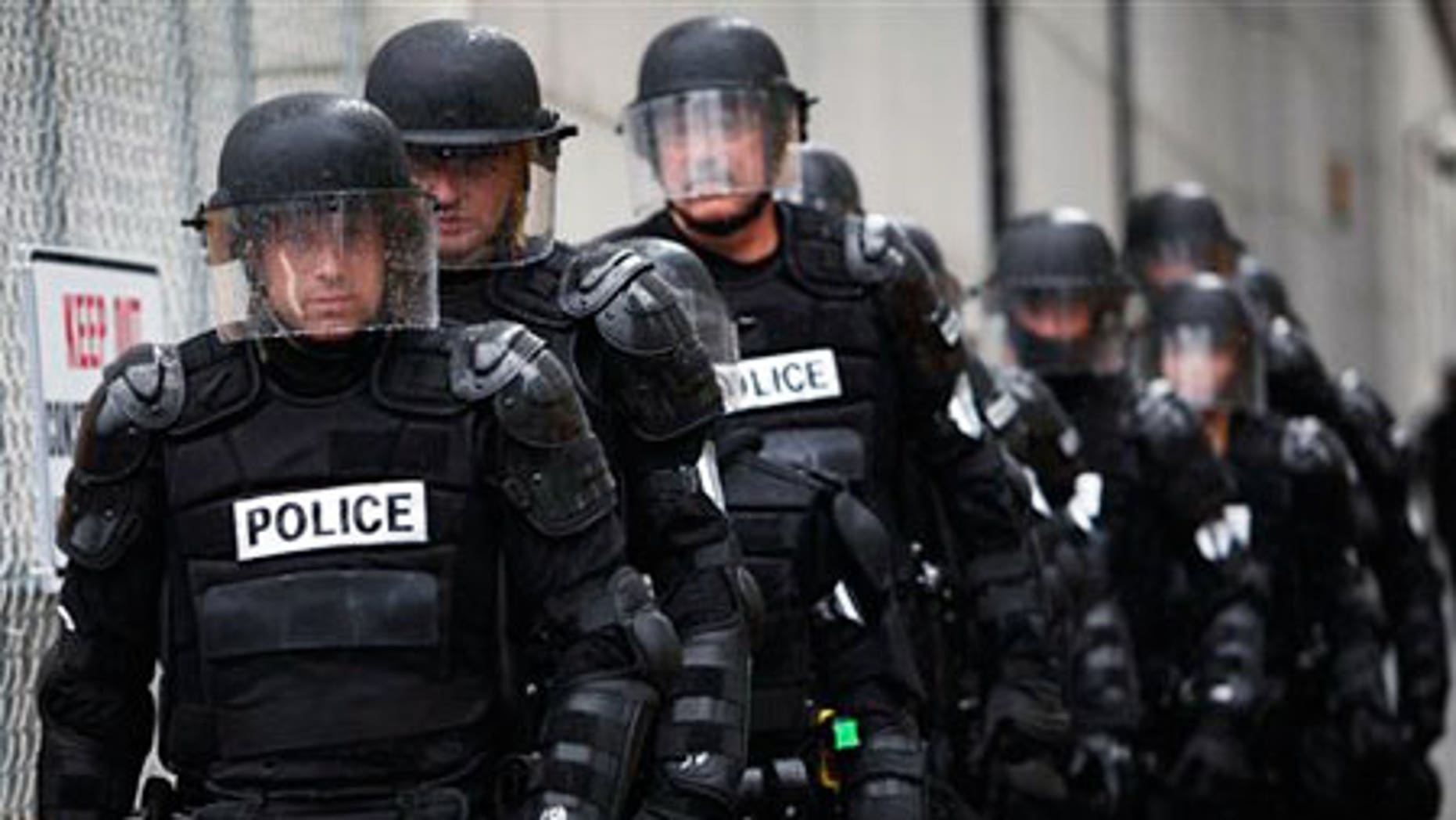 Sept. 22: Police officers in riot gear are seen in Pittsburgh.