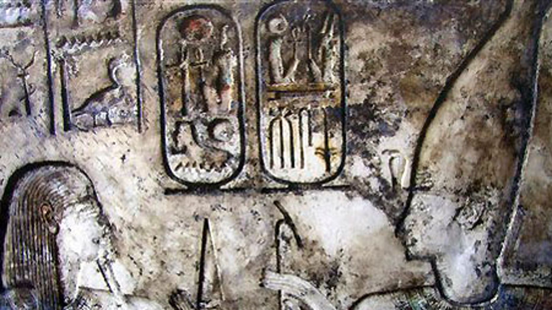 King Ramses II, right and Geb, goddess of earth, carved on a wall at one of four recently unearthed new temples in Qantara, Egypt.