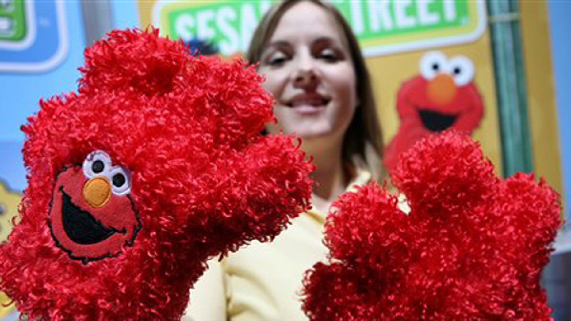 Feb. 18: Taryn Pry with Fisher Price shows off Elmo Tickle Hands, a touch activated toy featuring Sesame Street's Elmo.