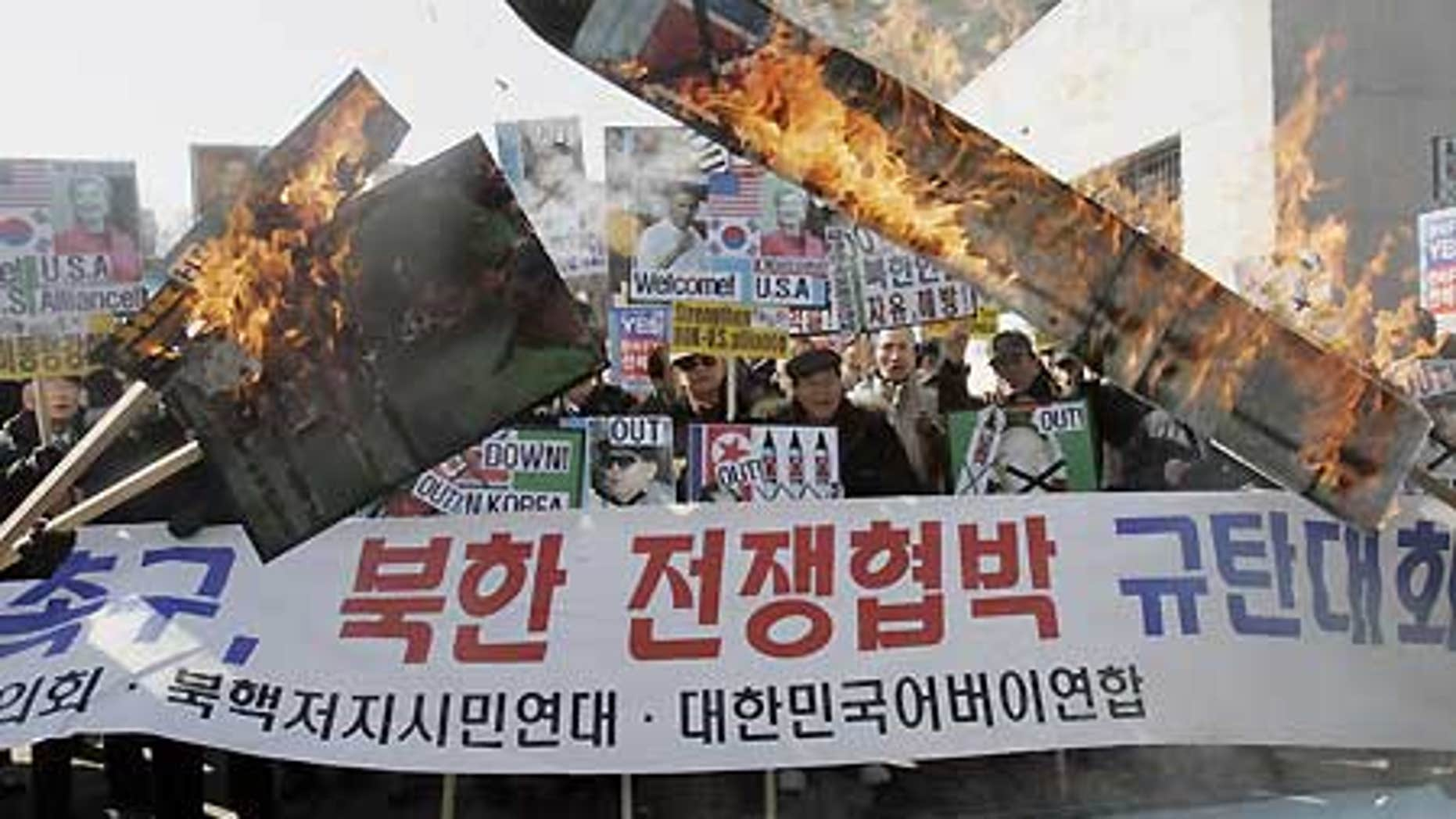 Feb. 17: South Korean protesters burn a portrait of North Korean leader Kim Jong Il and mock North Korean missile during a rally in Seoul.