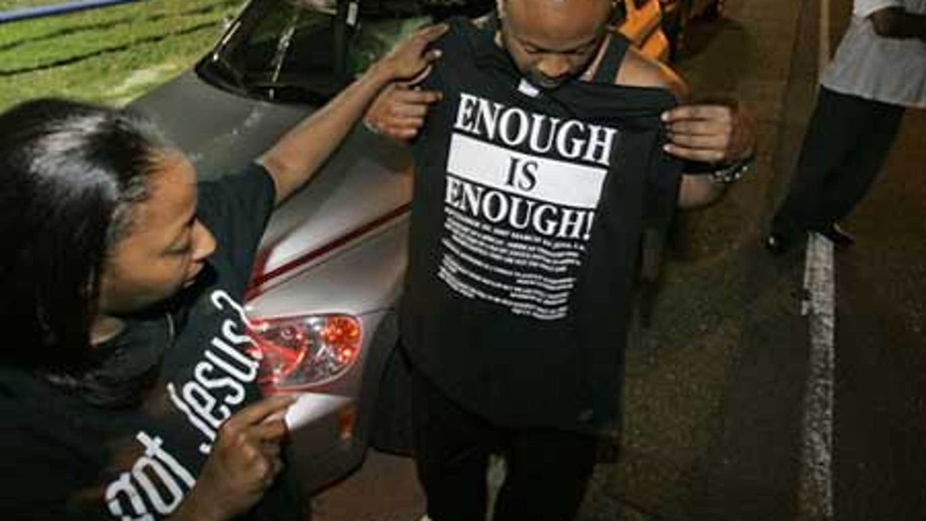 Sept. 20: Andrea Blalock, left, checks out a shirt for her husband Thomas Blalock, both from Stockbridge, Ga. as they prepare for a rally to protest the arrest of the 'Jena 6'in Louisiana. The youngest of the six was released Thursday.