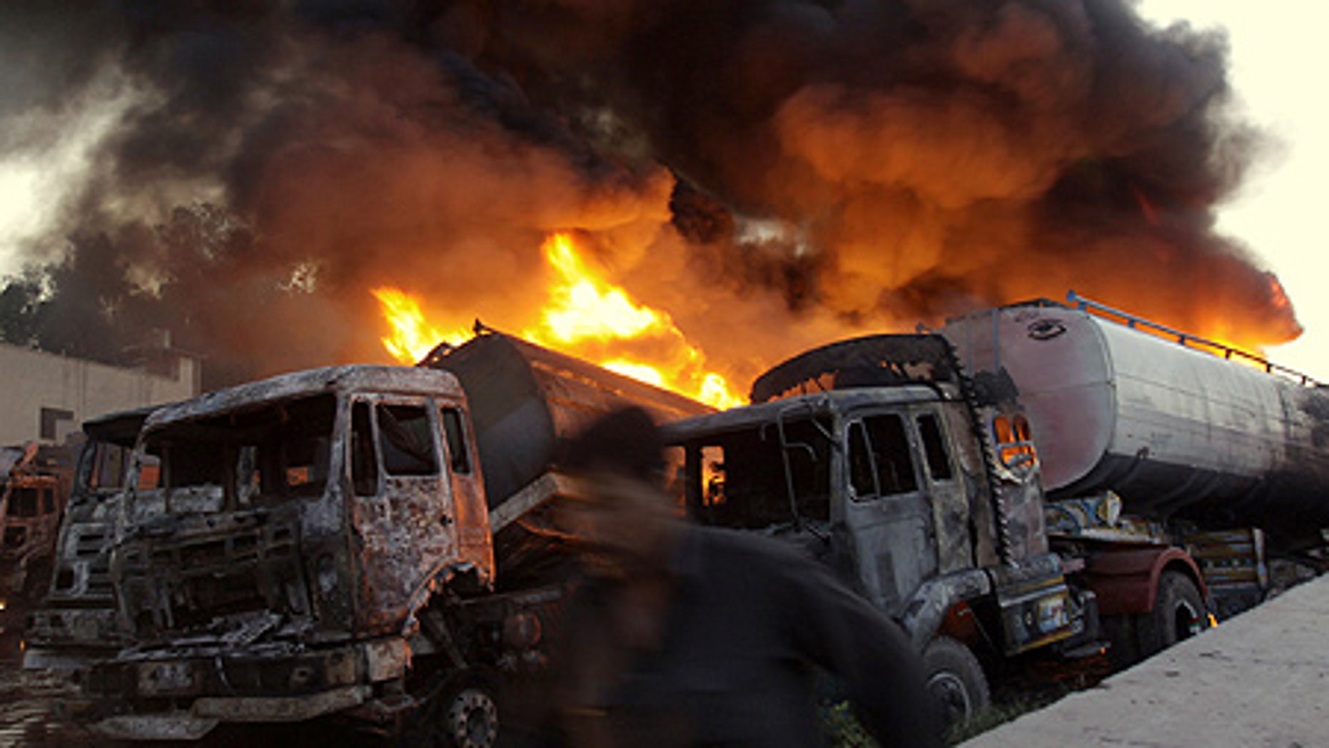Apr. 23: Dozens of militants armed with guns and gasoline bombs attack NATO's truck terminal in Peshawar, Pakistan.