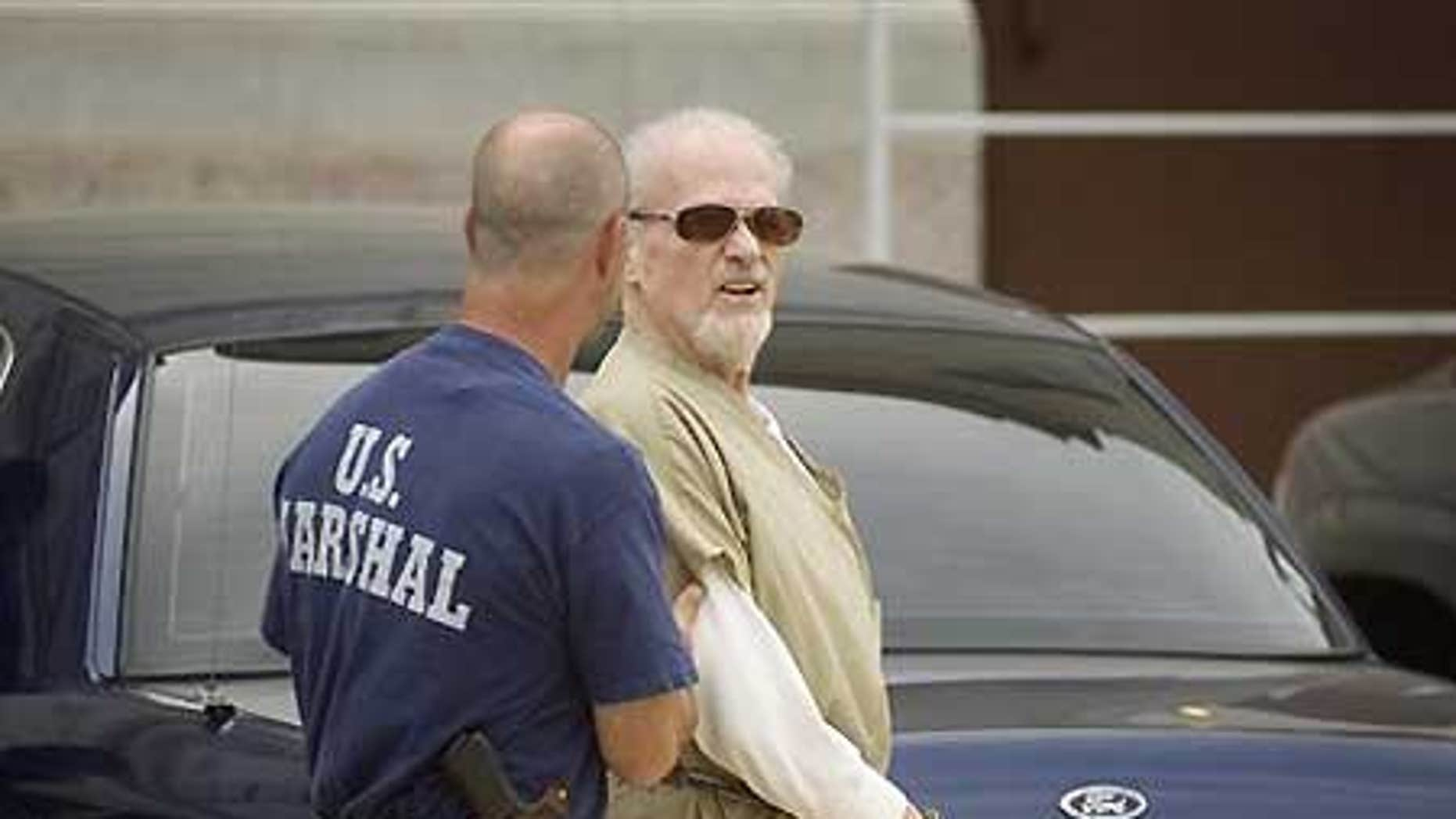 July 14: Evangelist Tony Alamo is led from the federal courthouse in Texarkana, Ark., following opening statements in his trial.