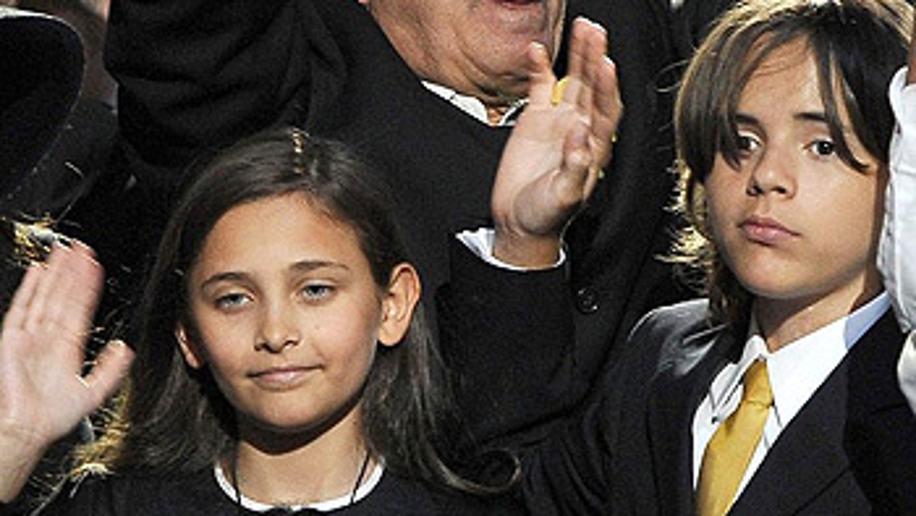 July 7: Michael Jackson's daughter Paris and two sons Prince Michael II (Blanket) and Prince Michael at the singer's memorial in L.A.