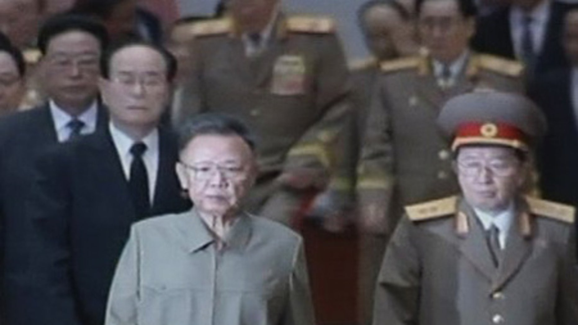 July 8: North Korean leader Kim Jong Il arrives at the 15th anniversary of the death of Kim Il-sung, his father and founder of the country.