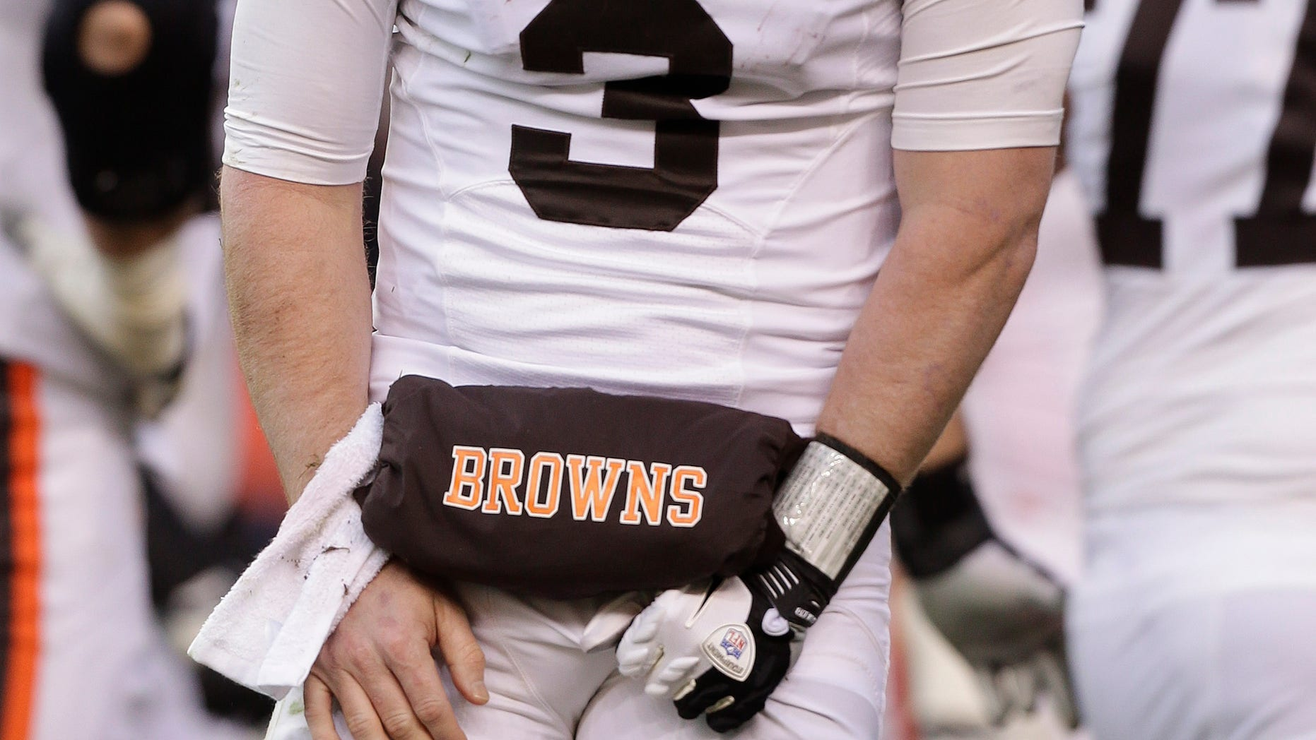 Cleveland Browns quarterback Brandon Weeden (3) reacts after being injured on a sack by the Denver Broncos in the third quarter of an NFL football game, Sunday, Dec. 23, 2012, in Denver. (AP Photo/Joe Mahoney)
