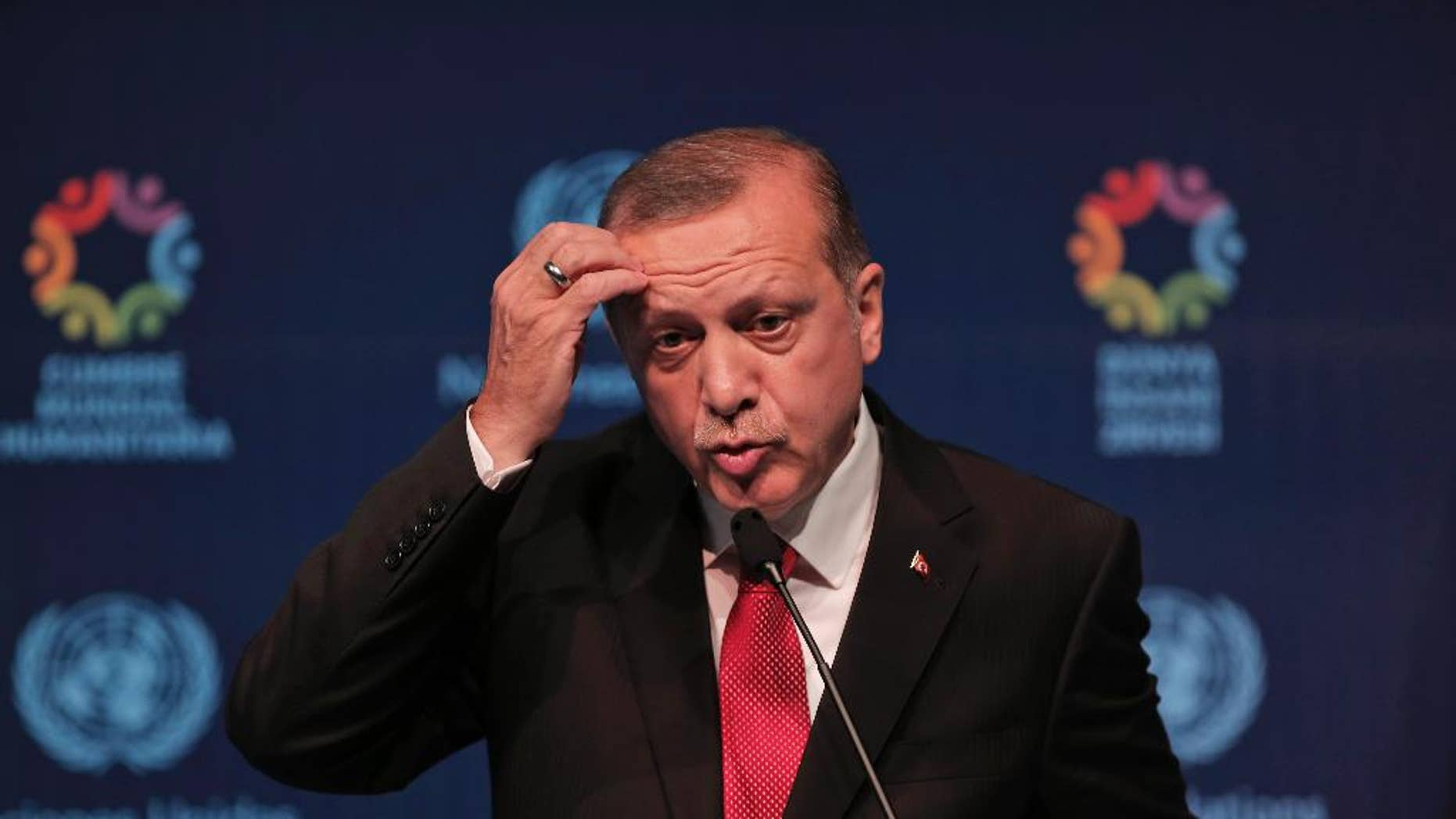 Turkish President Recep Tayyip Erdogan talks during a joint news conference with United Nations Secretary General Ban Ki-moon, at the the World Humanitarian Summit in Istanbul, Tuesday, May 24, 2016. World leaders and representatives of humanitarian organisations from across the globe gathered in Istanbul on May 23-24, 2016 for the first World Humanitarian Summit, focused on how to reform a system many judge broken. (AP Photo/Lefteris Pitarakis)