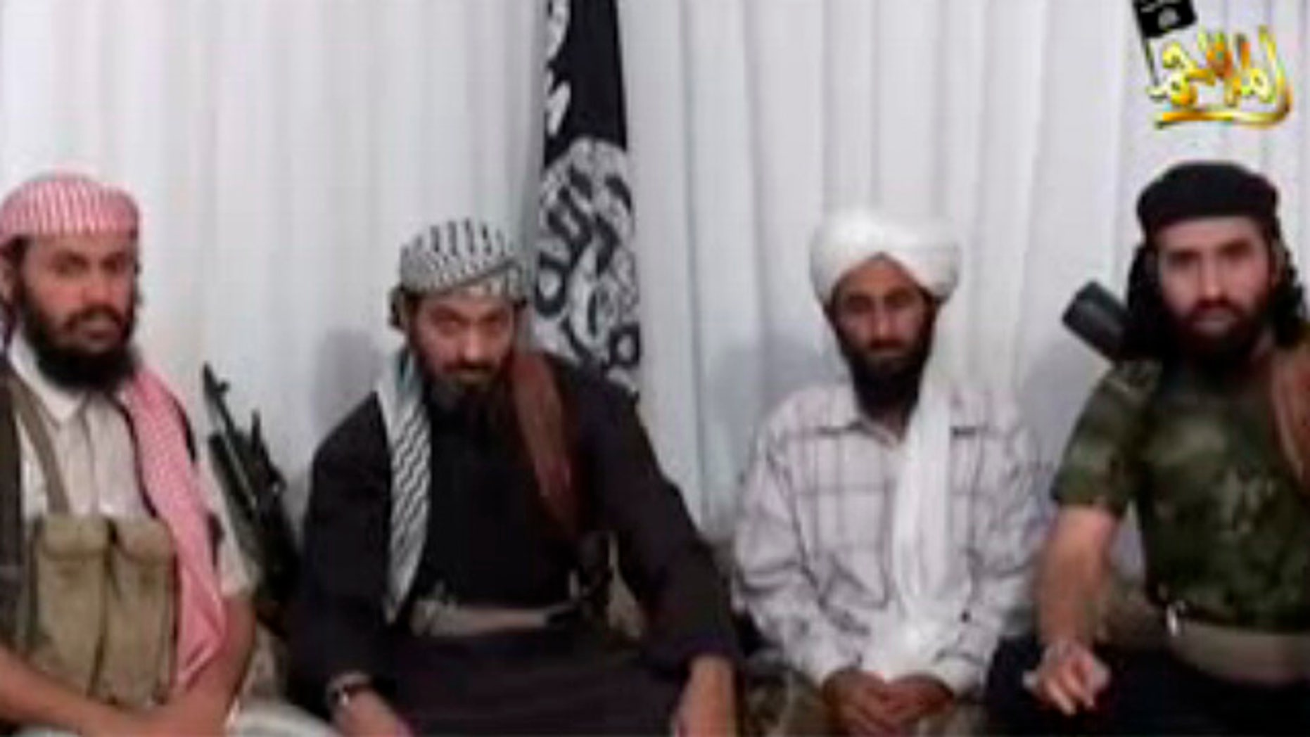 FILE:  Jan. 24, 2009. The leader of Al Qaeda in Yemen, Nasser al-Wahaishi, second from right, is surrounded by deputies in an Internet video.