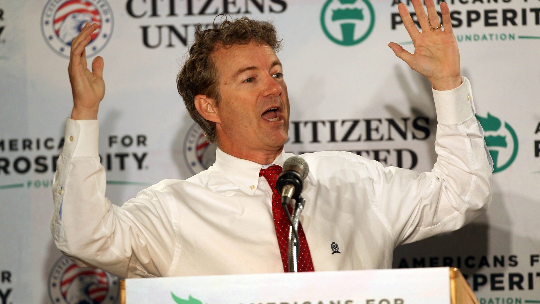 Sen. Rand Paul, R-Ky. speaks at a GOP Freedom Summit, Saturday, April 12, 2014, in Manchester, N.H.  Several potential Republican White House contenders _ among them Kentucky Sen. Rand Paul, Sen. Ted Cruz, and former Arkansas Gov. Mike Huckabee _ headline a conference Saturday in New Hampshire, hosted by the conservative groups Citizens United and Americans for Prosperity. (AP Photo/Jim Cole)