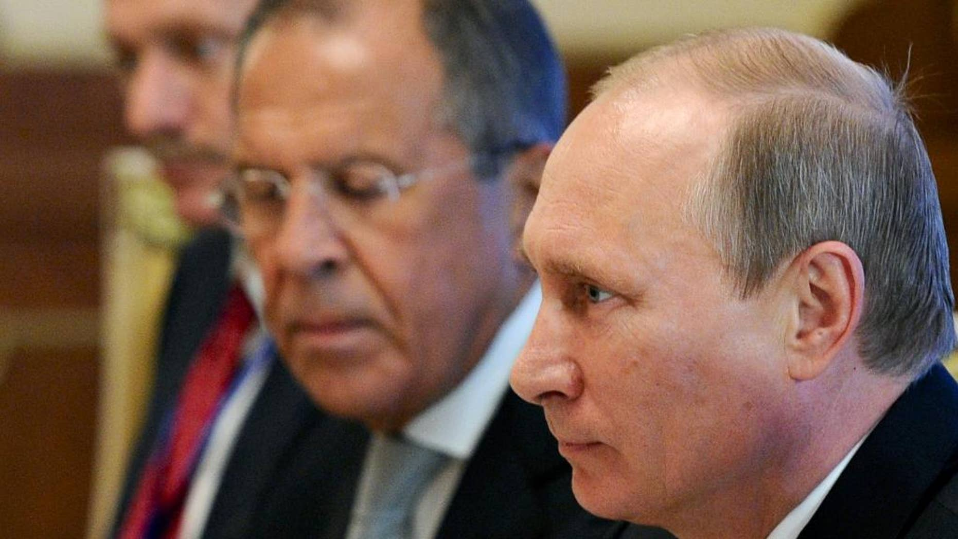 Sept. 11, 2014 - Russian President Vladimir Putin, right, speaks during his meeting with Chinese President Xi Jinping, at a summit in in Dushanbe, Tajikistan, as Russian Foreign Minister, Sergey Lavrov listens. New European Union sanctions against Russia announced Friday punish Moscow for what the West sees as efforts to destabilize Ukraine.