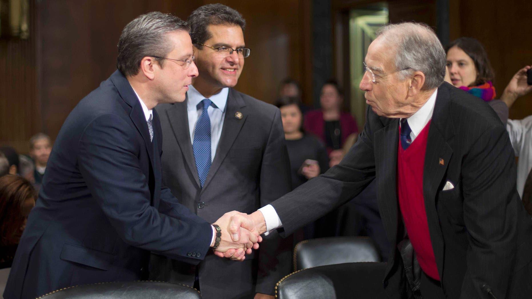 Sen. Chuck Grassley greets Puerto Rico Gov. Alejandro Garcia Padilla on Capitol Hill, Tuesday, Dec. 1, 2015.