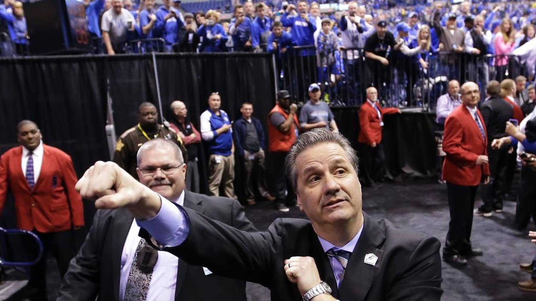 Kentucky head coach John Calipari celebrates after an NCAA Midwest Regional final college basketball tournament game against Michigan Sunday, March 30, 2014, in Indianapolis. Kentucky won 75-72 to advance to the Final Four. (AP Photo/David J. Phillip)