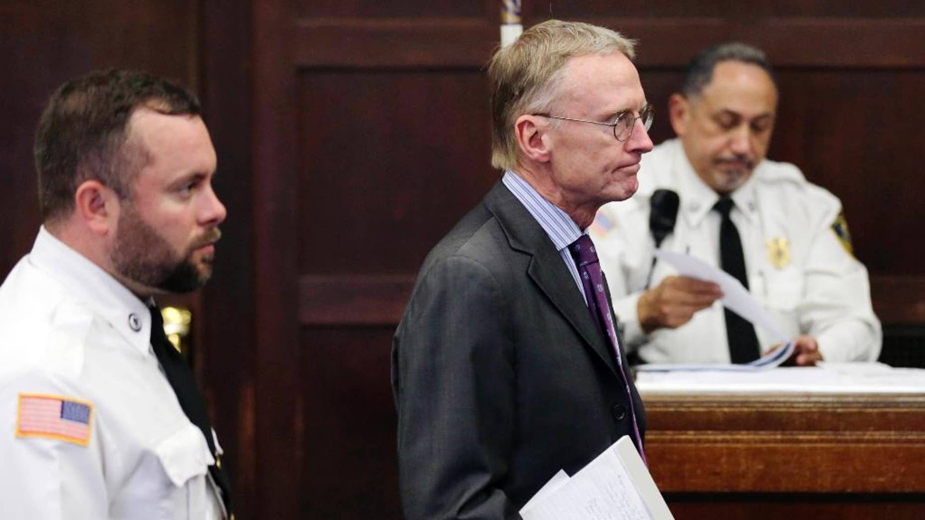 FILE - Charles Rankin, lawyer for former New England Patriots football player Aaron Hernandez, stands before Judge Jeffrey Locke during a hearing at Suffolk Superior Court in Boston, in this Oct. 21, 2014 file photo.  The lawyers for former New England Patriots player Aaron Hernandez are set to go before a judge Thursday Oct. 30, 2014 to argue that his trial in the 2013 killing of a semiprofessional football player should be moved because of intense pretrial media coverage. (AP Photo/Charles Krupa, Pool, File)