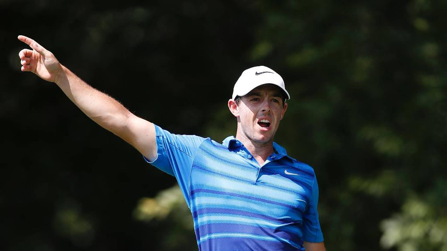 Rory McIlroy warns spectators of his errant shot on the second tee during the second round of play at the Tour Championship golf tournament at East Lake Golf Club Friday, Sept. 23, 2016, in Atlanta. (AP Photo/John Bazemore)
