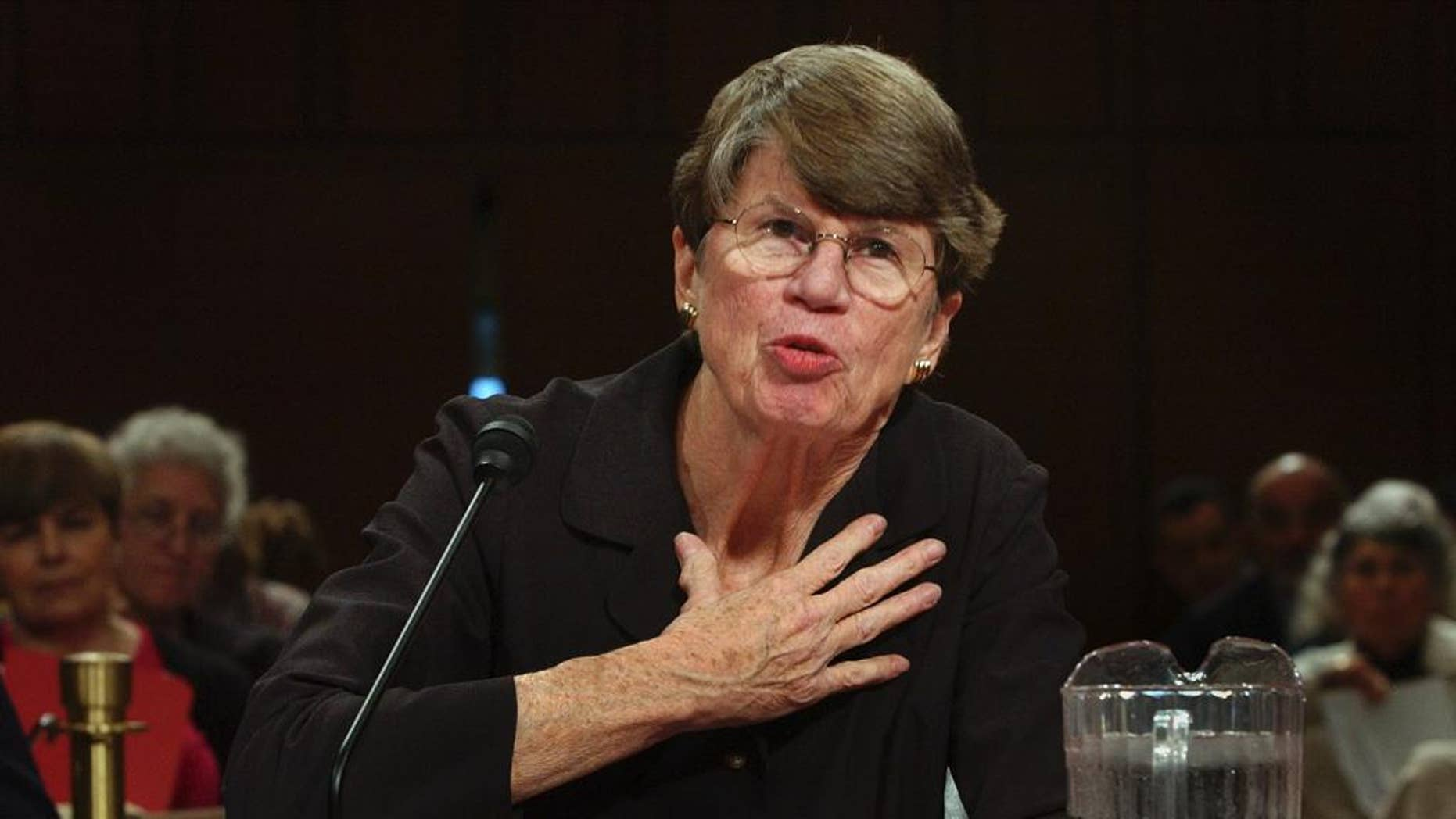 FILE- In this Tuesday, April 13, 2004, file photo, former U.S. Attorney General Janet Reno testifies before the commission investigating the Sept. 11 attacks on Capitol Hill in Washington. The South Florida home where Reno lived will be preserved and donated to Miami-Dade College. It's slated to become part of the environmental center at the college's campus south of Miami. (AP Photo/Dennis Cook, File)