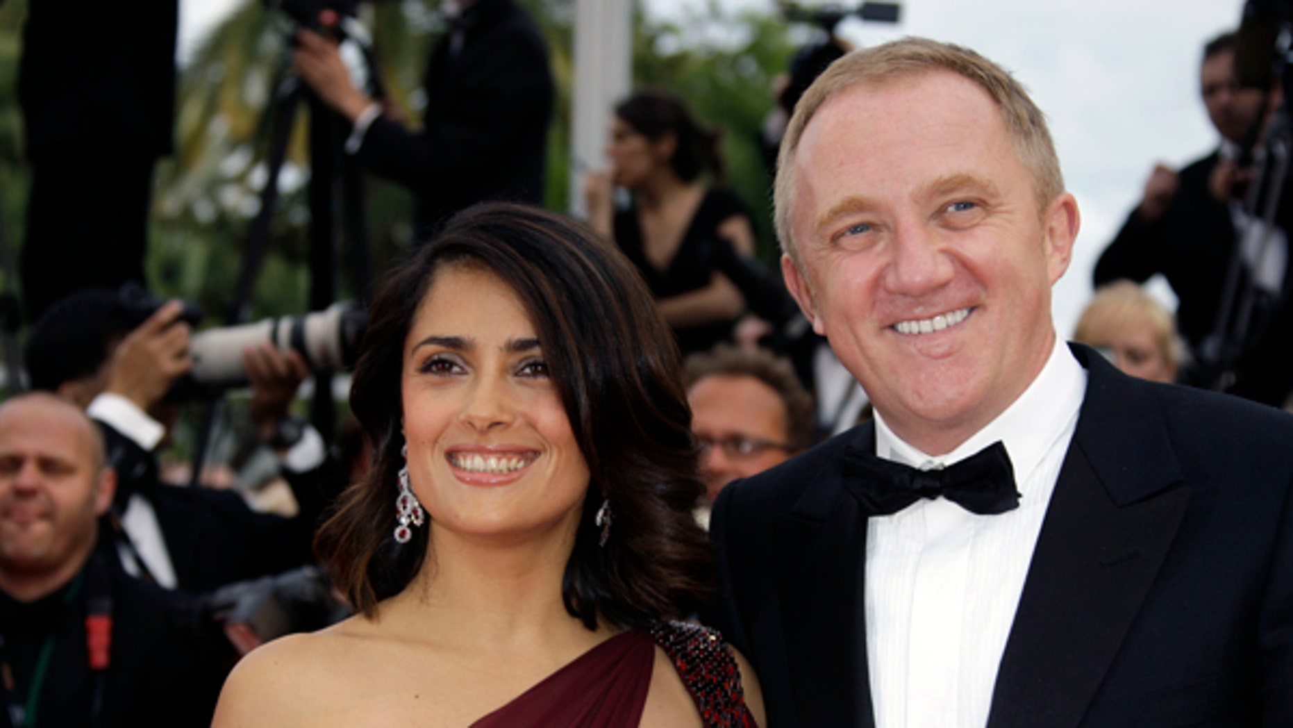 """Actress Salma Hayek and husband François-Henri Pinault arrive at the premiere for the film """"Robin Hood"""", at the 63rd international film festival, in Cannes, southern France, Wednesday, May 12, 2010. (AP Photo/Joel Ryan)"""