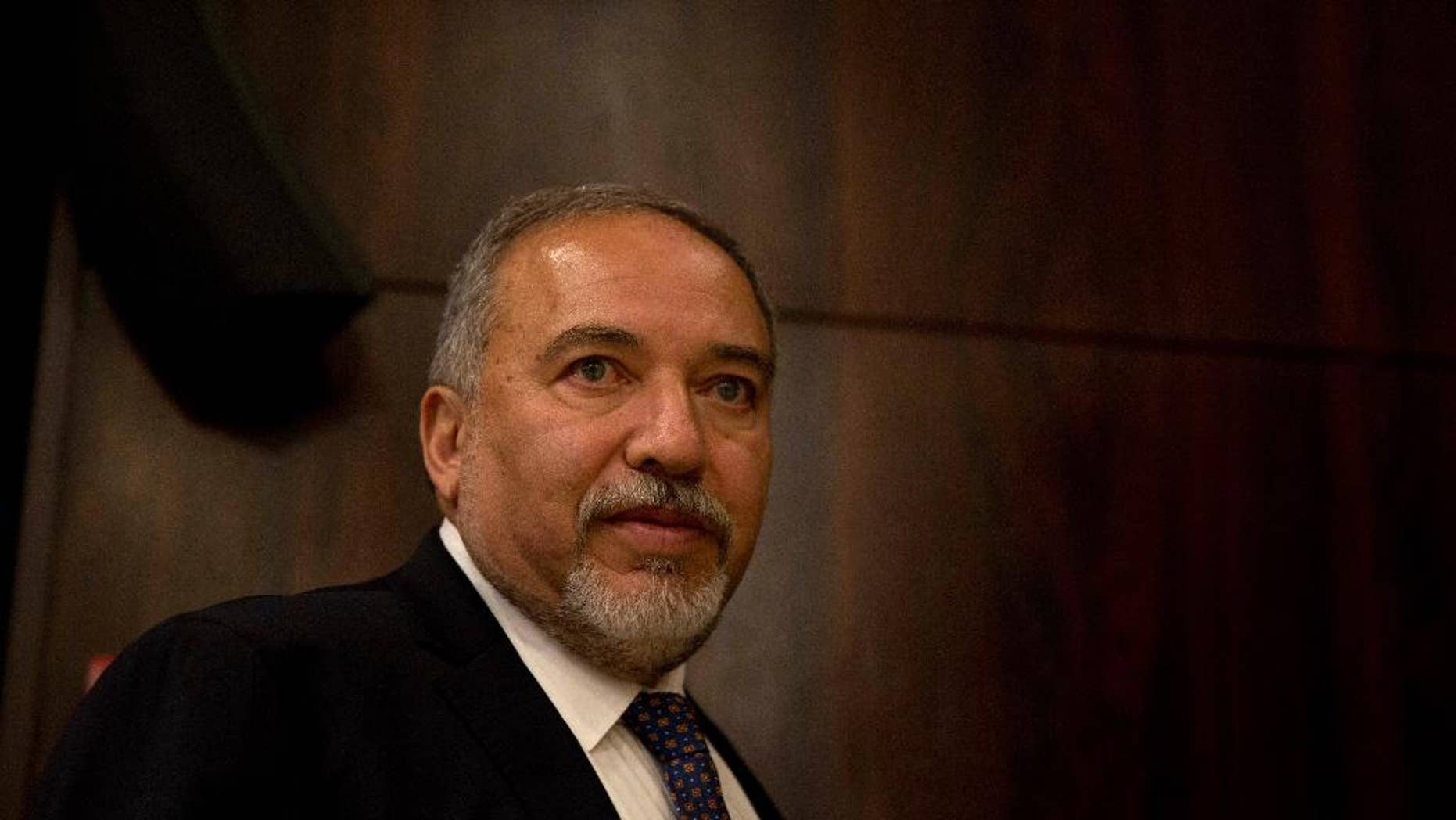 FILE -- In this May 30, 2016 file photo, Israeli Defense Minister Avigdor Lieberman appears at the Knesset, Israel's parliament, before his swearing-in ceremony, in Jerusalem. The Palestinian newspaper Al Quds, published a rare interview with Lieberman, where he reiterated his long held positions on Monday, Oct. 24, 2016. But for a Palestinian paper to interview an Israeli official is unusual and it comes at a time of heightened tensions and mistrust between the sides. Lieberman warned Gaza's Hamas rulers and dismissed Palestinian President Mahmoud Abbas. Palestinians were angered by the interview. (AP Photo/Ariel Schalit, File)