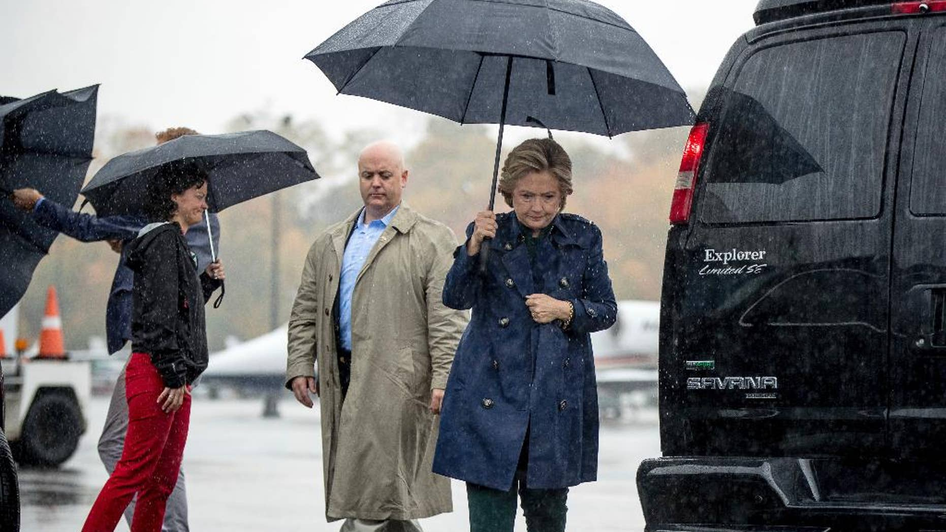 Democratic presidential candidate Hillary Clinton arrives to board her campaign plane at Westchester County Airport in White Plains, N.Y., Friday, Oct. 21, 2016, to travel to Cleveland for a rally. (AP Photo/Andrew Harnik)