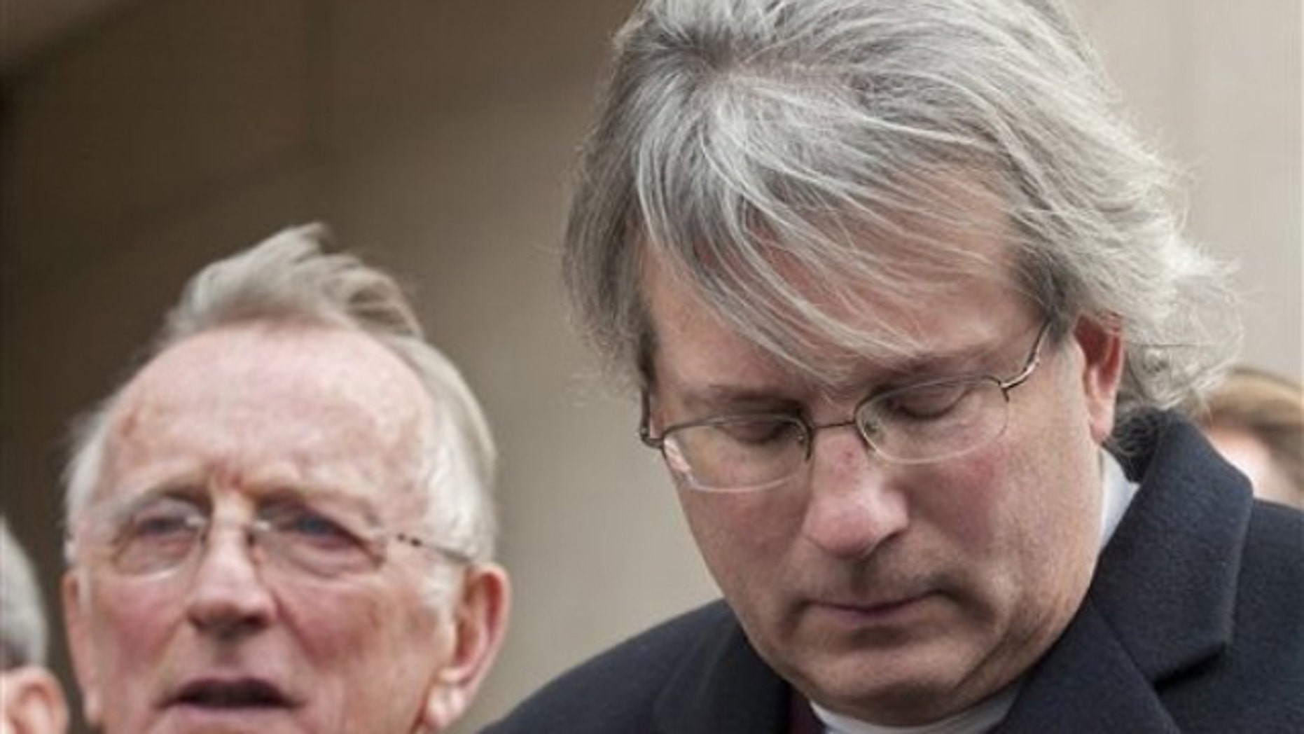 Nov. 8: Dr. William A. Petit Jr. , right, and his father William Petit, left, react to the sentence given to Steven Hayes following jury deliberations at the New Haven, Conn. , County Courthouse (AP).