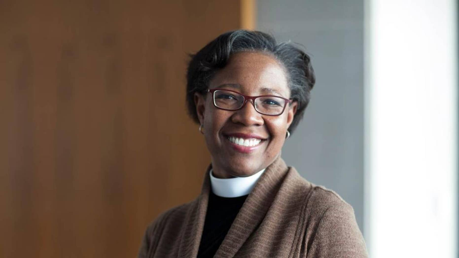 This undated photo provided by Charlie Simokaitis shows the Rev. Jennifer Baskerville-Burrows. The Episcopal Church has elected the first black woman to lead one of its dioceses. The Rev. Jennifer Baskerville-Burrows was elected Friday, Oct. 28, 2016 to head the Diocese of Indianapolis. (Charlie Simokaitis via AP)