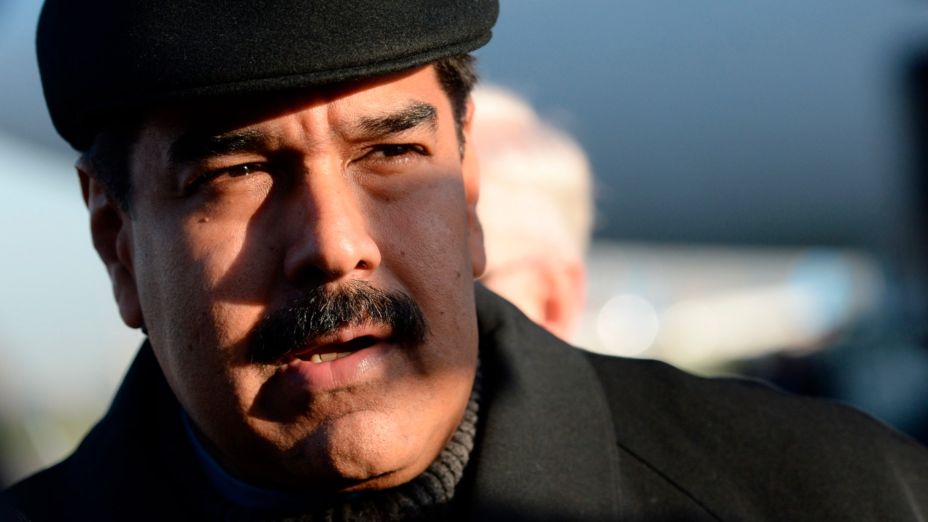 FILE - In this Friday, May 8, 2015, file photo, Venezuela's President Nicolas Maduro is on his arrival at Vnukovo airport in Moscow. Whether its from corruption scandal or stagnant growth, the prospects for the crop of leftist Latin American presidents that have been running the region since the start of the millennium appear to be dimming. No leader has been harder hit than Venezuelan President Nicolas Maduro, who's approval ratings have tumbled amid the crisis to 28 percent, near the lowest in 16 years of socialist rule, and while theres no sign the sometimes violent street protests that overwhelmed the country a year ago will return anytime soon, polls indicate that the opposition will coast to victory in legislative elections expected to take place by year end. (RIA Novosti Pool Photo via AP, File)