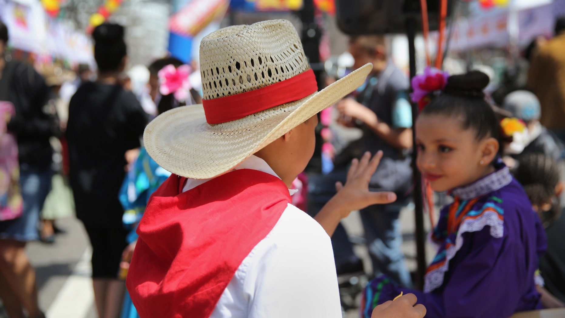 DENVER, CO - MAY 04:  Children dressed in traditional Mexican attire attend a Cinco de Mayo festival on May 4, 2013 in Denver, Colorado. Hundreds of thousands of people were expected to attend the two day event, billed as the largest Cinco de Mayo celebration in the United States. Cinco de Mayo observes the victory of the Mexican army over French forces on May 5, 1862 in the town of Puebla, Mexico. The festival celebrates Mexican culture and is one of the most popular annual Latino events in the United States.  (Photo by John Moore/Getty Images)